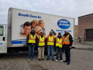 duct cleaning truck with technicians