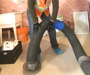 unique providers technician cleaning the work area